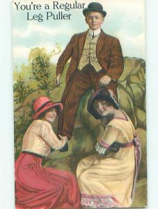 Unused Pre-Linen TWO WOMEN PULL UP AT THE LEGS OF MAN k9398