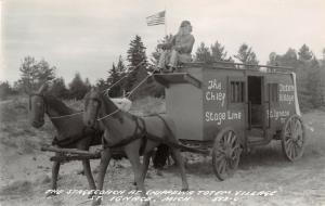 St Ignace MI~Totem Pole Village Indian Chief Rides Atop Stage Coach~RPPC c1950