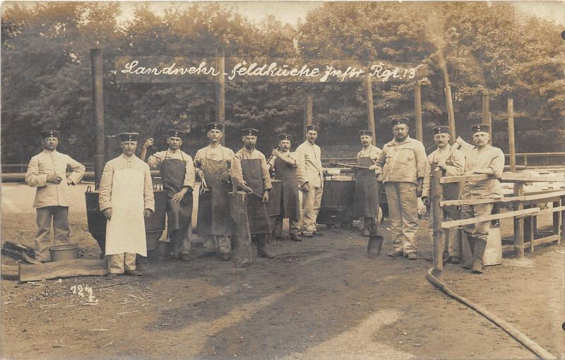 German Military Kitchen in Field~Rgt 13~WWI~Chefs Chopping Wood~1914 RPPC