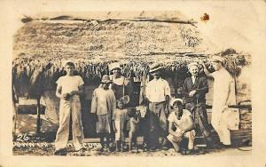 Down in Sunny Cuba Natives & Sailors Thatched Roof Home Real Photo Postcard