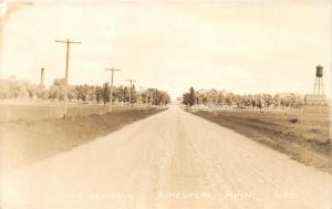 Pipestone Minnesota~Dirt Road Leading to Indian Schools~Water Tower~1930s RPPC