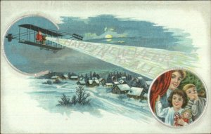 Christmas - Santa Claus Flying Airplane HAPPY NEW YEAR c1910 Postcard
