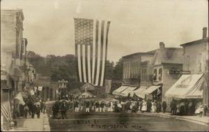 Bloomington WI Canal St. Huge American Flag & Crowd Real Photo Postcard