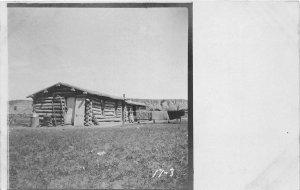 F83/ Bixby South Dakota Postcard RPPC c1910 Log House Cabin Building