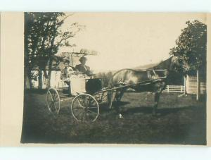 rppc Pre-1920's WOMEN HAVE UMBRELLA COVERING FOR THEIR CARRIAGE AC7991