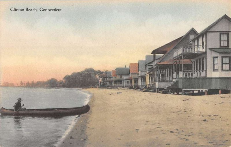 Clinton Beach Connecticut man in boat on beach by houses antique pc ZE686208