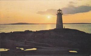 An evening view of the lighthouse at Peggy's Cove,   Nova Scotia,  Canada,   ...