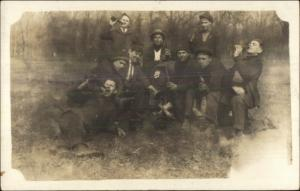 Group of Men Being Silly Drinking Beer From Bottles c1910 Real Photo Postcard