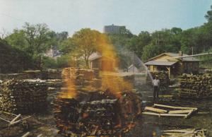 Making charcoal at Jack Daniel's Distillery, Lynchburg, Tennessee, 40-60s