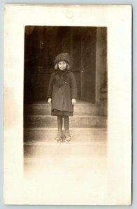 Real Photo Postcard~Wide Eyed Little Girl on Steps in Roller Skates~c1912 RPPC