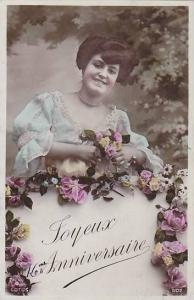 RP; Hand-colored, Joyeux Anniversaire, Woman standing behind wall decorated b...