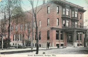 Antigo Wisconsin~Hotel Butterfield~Gentleman Leans On Post~Dirt Road~1911