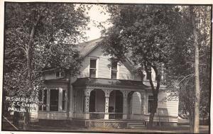 Paullina Iowa~Grain Dealer (w/Metcalf) Cannon Home~Fancy Porch Rails RPPC 1910