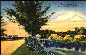 MIAMI, Seminole Village tourist spot + bus at Tamiami Trail in Everglades, 1940