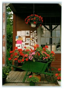 Postcard New England County Store wheel barrow of flowers NES33 K3