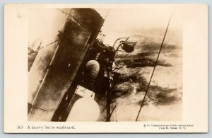 WWI US Navy Battleship~Heavy List to Starboard~Life Boat Swings Out~N Moser RPPC
