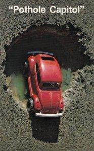 VW Bug in a pothole , 50-60s