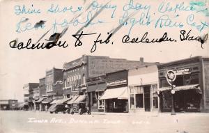 Dunlap IA~Iowa Avenue~Elliott's 5&10 Cent Store~Western Auto~1930s Cars~RPPC