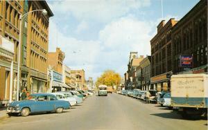 St Johnsbury Vermont~Railroad Street~Storefronts~50s Cars & Trucks~Postcard