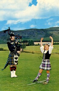 UK - Scotland. Pitlochry's Pipe Major and Highland Dancer
