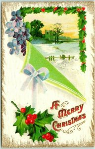 1910s A MERRY CHRISTMAS Embossed Greetings Postcard Winter Scene / Holly Border