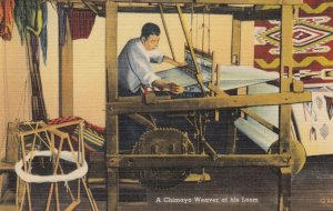 A Chimayo weaver at his loom , New Mexico , 1930-40s