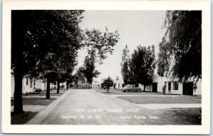 Cedar Rapids, Iowa RPPC Postcard TWIN TOWERS TOURIST COURT Highway 30 Roadside
