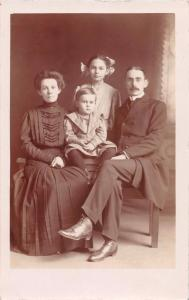 FAMILY~HUSBAND~WIFE~DAUGHTER~SON~POSE VICTORIAN PERIOD REAL PHOTO POSTCARD 1918