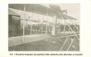 Wilbur Wright examines the Aeroplane before flight (1950's Repro)