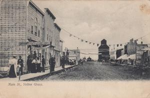 YELLOW GRASS , Sask. , Canada , 1900-10s ; Flags across Main Street