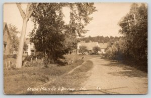 Wilton-East Dixfield ME~Man Stands By His House on Dirt Lower Main St~RPPC c1910