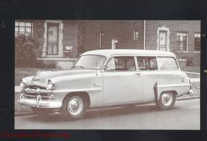 1954 PLYMOUTH PLAZA SUBURBAN STATION WAGON CAR DEALER ADVERTISING POSTCARD