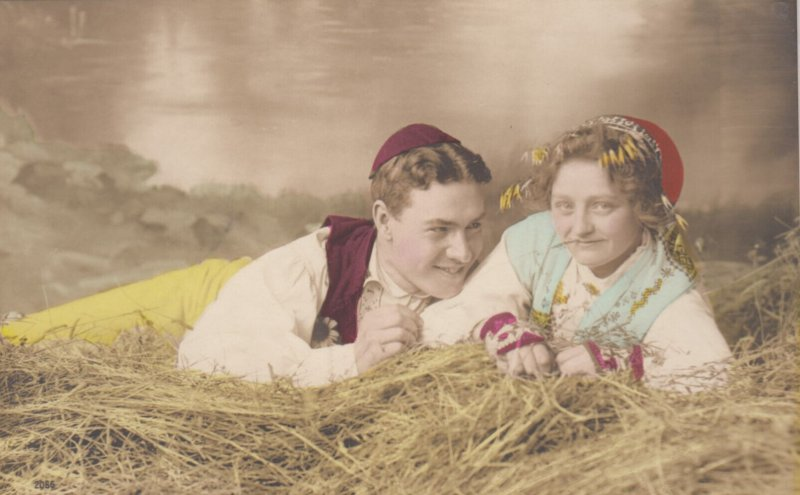 RP: Couple laying in hay , Norway , 00-10s