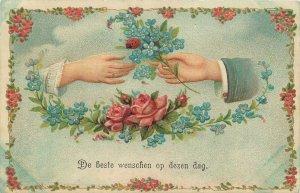 Early embossed greetings postcard Bonne annee shamrock flowers souvenir hands