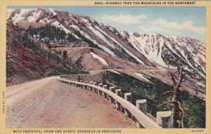 Highway Thru The Mountains In The Northwest With Perpetual Snow And Scenic Gr...