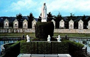 Ohio Fatima Statuary Group Protruding From The Lake Our Lady Of Fatima Shrine