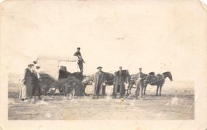 Real Photo Postcard~Victorian Men & Ladies Walk W/ Covered Wagon~Mud Wheels~1912