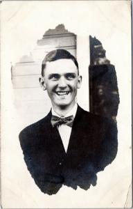 RPPC: Very smiley guy in a bow tie - posted 1912, Avon Iowa