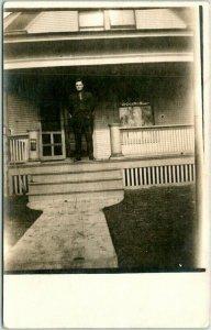 LINCOLN, Nebraska RPPC Real Photo Postcard Man on Porch / House View 1914 Cancel