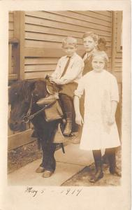 3 Young children & a donkey Child, People Photo Unused