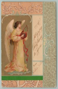 Clapsaddle Christmas~Angel Plays Handheld Lyre Harp~Yellow Gown~Art Nouveau~1903
