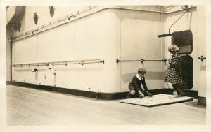 c1920 Real Photo Postcard; Children Playing a Toss Game on Cruise Ship, Europe