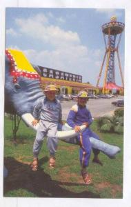 Children sit on Elephant's tusks, South of the Border, South Carolina, 40-60s