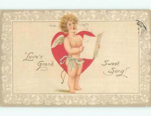 Pre-Linen valentine CUPID SINGING FROM SHEET MUSIC J0967