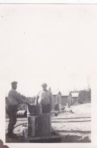 RP: Logging Camp 12 , Minnesota, 1910s ; 2 men