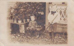 RP: STANTON , Missouri , 1908 ; Kids with toy wagon