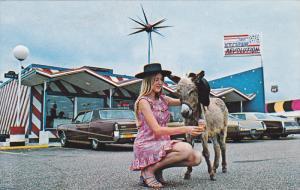 Blond Lady feedng ice cream to miniature donkey, Pedro's Ice Cream Revolution...