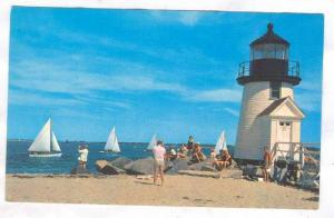 Sailboat racing off beautiful brant point lighthouse beckons the summer vacat...