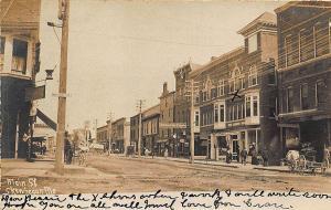 Skowhegan ME Bucknam's Storefronts Horse & Wagons Postcard