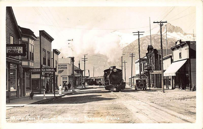 Skagway AK Street View Store Fronts White Pass Train RPPC Postcard